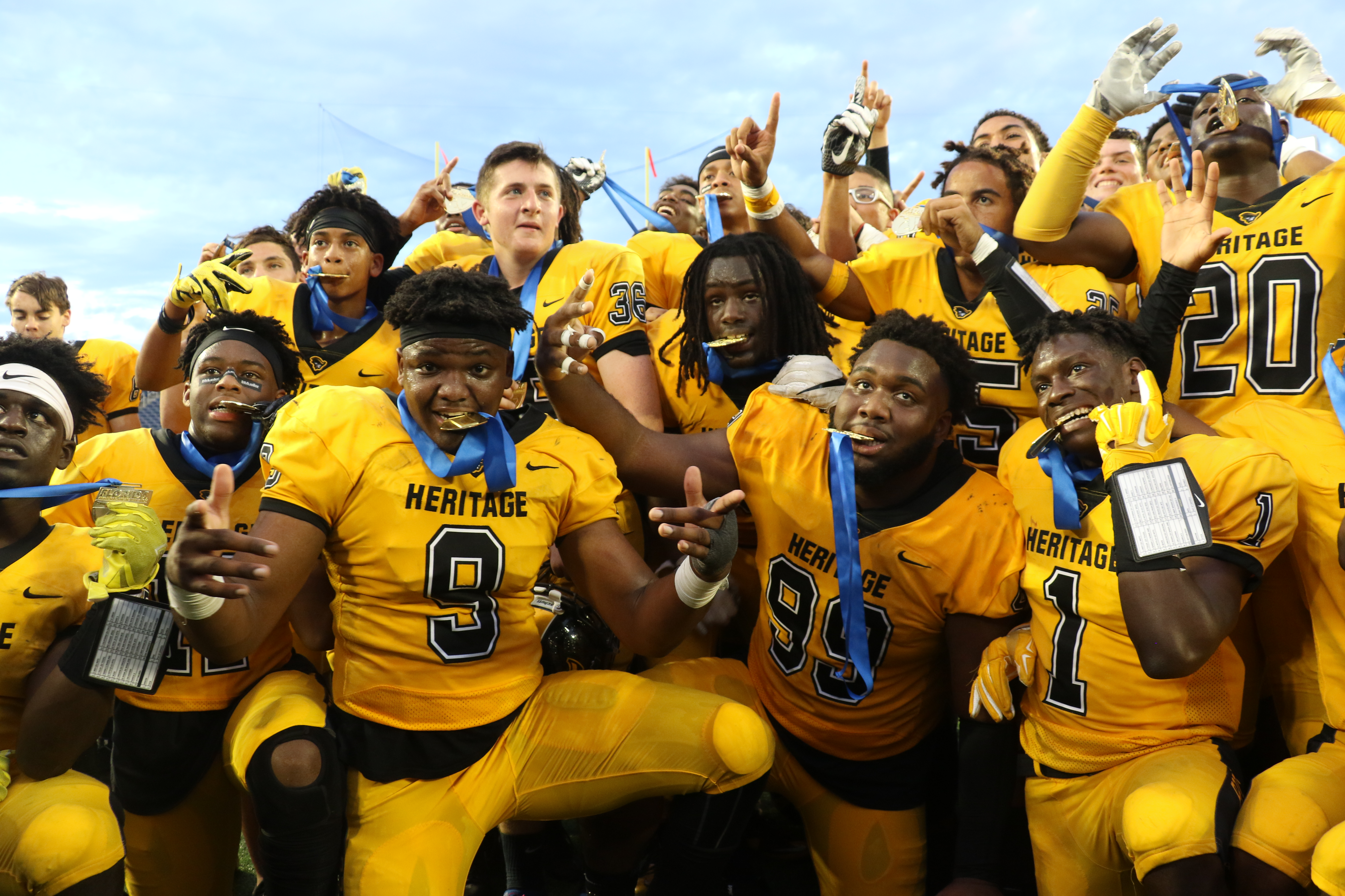 Plantation American Heritage DE Andrew Chatfield & his Patriots after winning 5A State Championships