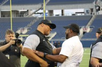 Oronde Gadsden and Head Coach Pat Surtain celebrate